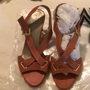 Orange brown Tahari sandals.